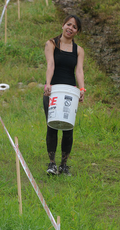 Amesbury: Jennifer Bobb carries a bucket of gravel in the Spatran Race at Amesbury Sports Park Saturday. Jim Vaiknoras/Staff photo