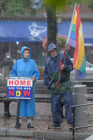 Newburyport: Claire Paulsen and her husband, Paul, of Haverhill continue the weekly Market Square Peace Vigil during Sunday's storm. The vigil has been held every Sunday since the start of the Iraq War in 2003. Jim Vaiknoras/Staff photo