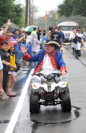 Newburyport: Yankee Homecoming Town Crier Zack Longley rides the paparde on an ATV in the rain Sunday. jim vaiknoras/staff photo