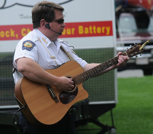 Wenham: Wenham police chief Kenny Welch plays with the band Blue Streak at the annual  BBQ at the Wenham fire station Saturday morning during <br /> Wenham Museum's 39th annual Family Festival and Craft Fair<br /> <br /> <br />  Jim Vaiknoras/Staff photo