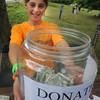 Newburyport: Georgi Munick  collects donation at Family Day at Maudslay Saturday. Jim Vaiknoras/Staff photo