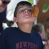 Merrimac: Alec Krohto, 11, competes in the donut eating contest at Merrimac Old Home Days at the Donahue School Saturday morning. Jim Vaiknoras/Staff photo