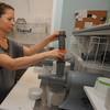 Newburyport: Tammy Kennelly , owner of Sip on Inn Street in Newburyport juices some vegetables at her store. Jim Vaiknoras/Staff photo
