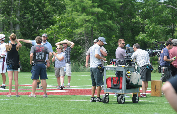 """Byfield: Crews film a scene in the upcoming movie""""Crooked Arrow"""" at the Governor's Academy Friday. Jim Vaiknoras/Staff photo"""