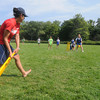 Newburyport:Sonia Mandonca one of the coaches with the US Sports Institute takes a turn with the cricket bat at Perkins Park Friday. Kids were played cricket along with handball, hockey, Frisbee, and other sports at teh week long camp sponsered by Newburyport Youth Services. Jim Vaiknoras/Staff photo