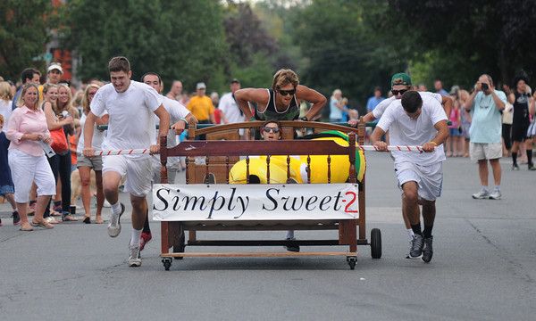 Newburyport: The Simply Sweet 2 races to victory in the Yankee Homecoming Bed Race on Federal Street Thursday night. JIm Vaiknoras/Staff photo