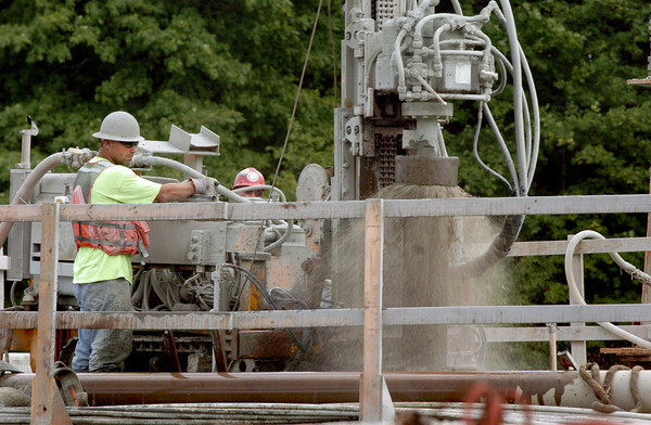 Amesbury: Workers on the reconstruction of the Hines Bridge remove the large drill that makes borings into the bedrock to help anchor the pier foundations. Bryan Eaton/Staff Photo