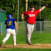 Rowley: Rowley Rams' Mareo Luisi scrambles back to third, past Townies' Brent Currier, forced back from home plate. Bryan Eaton/Staff Photo