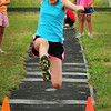 Newburyport: Gwen Ellis, 12, in the long jump at the Winner's Circle/Yankee Runner River Rivals Series at Fuller Field. Bryan Eaton/Staff Photo