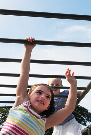 Amesbury: Ilise Litwin, left, and Jackie Fulmer, both 5, played on the monkey bars at the Amesbury Recreation Department's summer program. Friday is the last day of the program held at Amesbury Town Park and Camp Kent. Bryan Eaton/Staff Photo