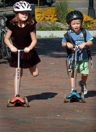 Newburyport: Emerson Clark, 5, and friend Will Tymowski, 4, both of Newburyport scooter about Newburyport's Market Square under yesterday's sunny sky. Bryan Eaton/Staff Photo