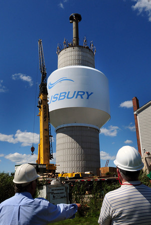 Salisbury: The top component of the new water tower was hoisted into place yesterday afternoon. The tank will hold half a million gallons. Bryan Eaton/Staff Photo