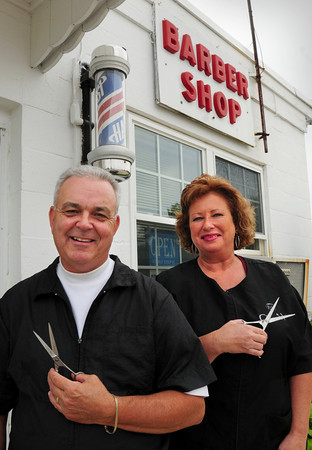 Salisbury: Larry and Kim Taylor have sold their barbershop in the East Parish Block in Salisbury Square. Larry's father Brud, who retired in 2001, started the business in 1951 and Larry joined him in 1977. Bryan Eaton/Staff Photo