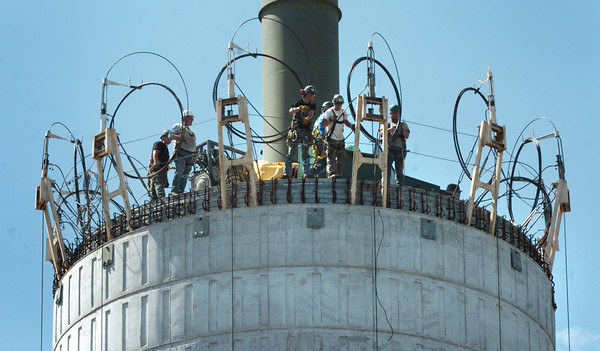 Salisbury: A work crew awaits on the top of the new water tower as the tank, out of view below, was raised yesterday afternoon and set into place. Bryan Eaton/Staff Photo