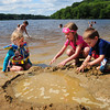 "Amesbury: Brittney Figulski, 3, of Amesbury, left, along with friends Abbey Dick, 5, and brother Brody, 3, of Tewksbury repair their ""pool"" at Lake Gardner Beach on Friday. Saturday's weather is another sunny day, but Sunday will have rain late in the afternoon or evening. Bryan Eaton/Staff Photo"