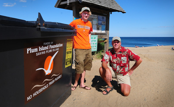 Newbury: Max Handler, left, and Joe Rolfe at the Plum Island Foundation's trash container at Plum Island Center. Bryan Eaton/Staff Photo