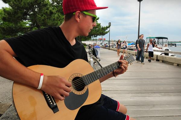 Newburyport: Stephen Dexter, 15, practices his guitar playing on Newburyport's waterfront on Monday afternoon. The Newburyport teen is member of the band Pandemonium. Bryan Eaton/Staff Photo
