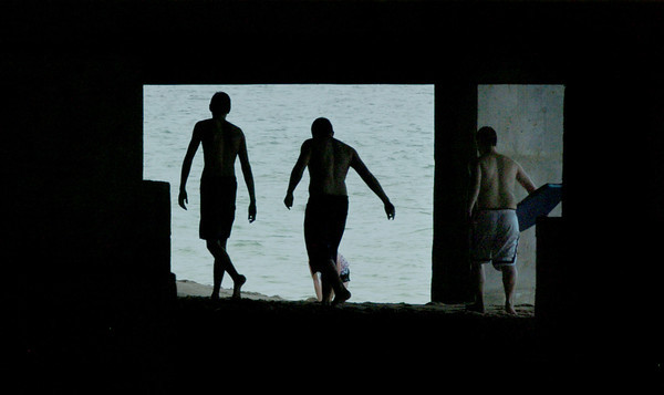 Salisbury: Beachgoers walk along at the bottom of the Pavillion yesterday afternoon. The week looks good for spending at the ocean or lakes. Bryan Eaton/Staff Photo