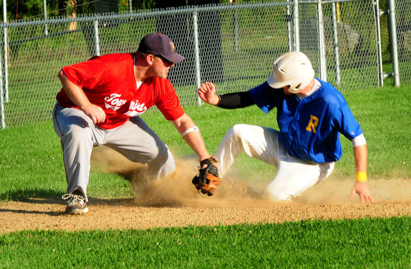 Rowley: Rowley Rams' Dave Smtih makes it safe to third past baseman Brent Currier. Bryan Eaton/Staff Photo