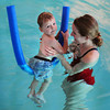 "Newburyport: Hunter McCormick, 22 months, of Newburyport floats along on plastic ""noodle"" with instructor Jenn Lewis. Bryan Eaton/Staff Photo"