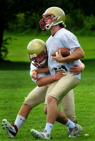 Newburyport: Newburyport High football practice started this week, here, they go though some drills at the Nock Middle School. Bryan Eaton/Staff Photo