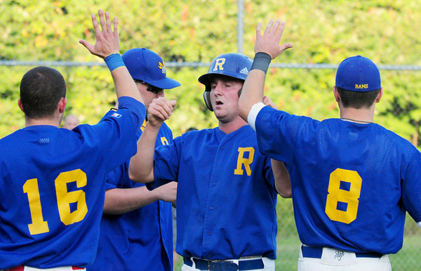 Rowley: Ralph Renzulli gets the high fives on a run batted in at Eiras Field. Bryan Eaton/Staff Photo