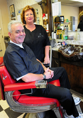 Salisbury: Larry and Kim Taylor have sold their Taylor's Barbershop in Salisbury Square and retiring to Myrtle Beach. The new owner will make virtually no changes in the business that Taylor's father started in 1951, Bryan Eaton/Staff Photo
