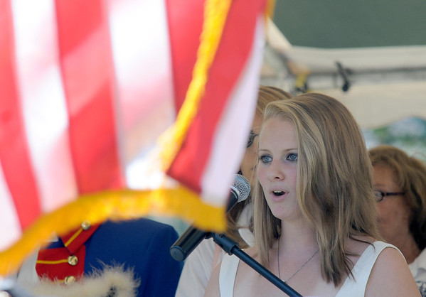 Newburyport: Kelsey Ryan of Amesbury sings the national anthem before the opening ceremonies at Yankee Homecoming's Old-Fashioned Sunday on the Mall. Jim Vaiknoras/Staff photo