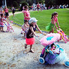 Newburyport: Children march around Atkinson Common in the doll carriage parade during Kids Day in the Park. Bryan Eaton/Staff Photo