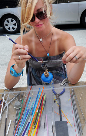 Newburyport: Kailey Burke or Haverhill makes glass jewelry on State Street fr the Market Square Craft Show. Bryan Eaton/Staff Photo