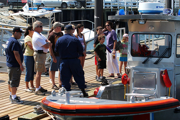 Newburyport: Visitors listen to a Coast Guardsman as they check out one of the Newburyport Surf Station's vessels Thursday afternoon. The station was giving tours of their facilities as part of the Yankee Homecoming festivities. Photo by Ben Laing/Staff Photo
