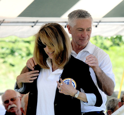 Newburyport: General Chairwoman Cheryl Munick is presented her blazer by last year's chairman, Don Walters, at opening ceremonies at Yankee Homecoming's Old-Fashioned Sunday on the Mall. Jim Vaiknoras/Staff photo