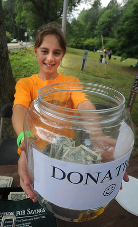 Newburyport: Georgi Munick  collects donation at Family Day at Maudslay Saturday. Jim Vaiknoras/Staff photo