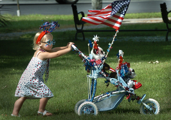 Newburyport: Justina Bucknill, 2, of Newbury pushes her Patriotic-themed carriage onto Atkinson Common for the Kids Day in the Park carriage parade. Bryan Eaton/Staff Photo