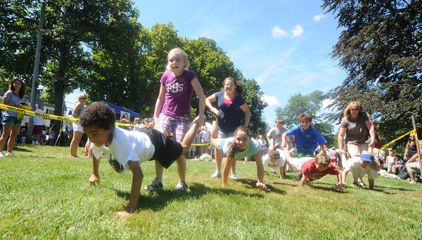 Newburyport: The pace is fast and furious in the wheelbarrow race at Yankee Homecoming's Old-Fashioned Sunday on the Mall.  Jim Vaiknoras/Staff photo