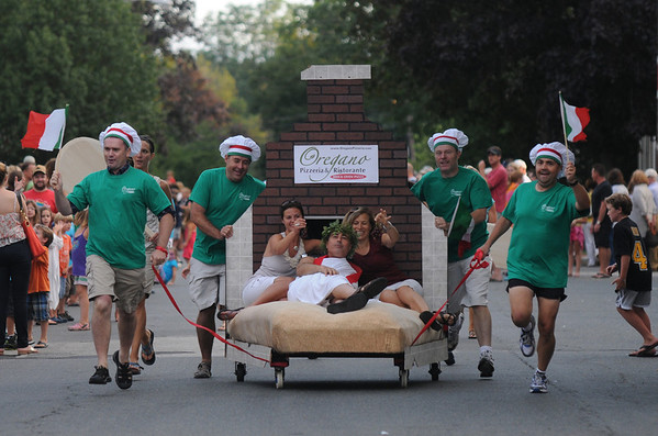 Newburyport: One of two entries from Oregano's finishes in the Yankee Homecoming Bed Race on Federal Street Thursday night. JIm Vaiknoras/Staff photo