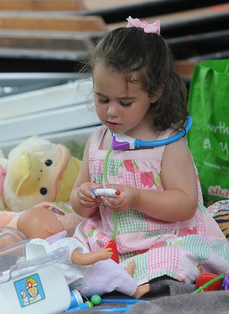 Newburyport:Emily Lenihan, 2, give her doll Abby a check up at the Anna Jaques Hospital tent at Family Day at Maudslay Saturday. Jim Vaiknoras/Staff photo