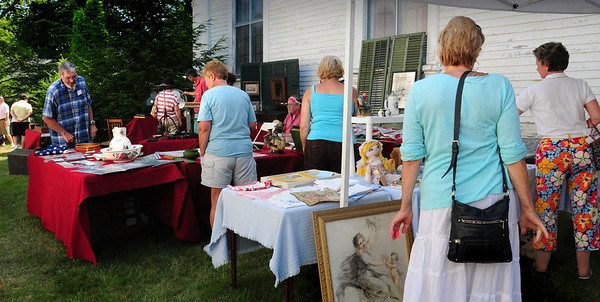 Newburyport: Items from pottery to postcards to old photograph supplies were on show at the Annual Antique Show and Sale at the Belleville Church. Bryan Eaton/Staff Photo