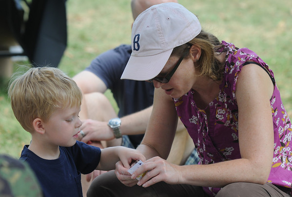 Newburyport:Will Bean and his mom Mimi look over some of the first aid  supplies at the Anna Jaques Hospital tent at Family Day at Maudslay Saturday. Jim Vaiknoras/Staff photo