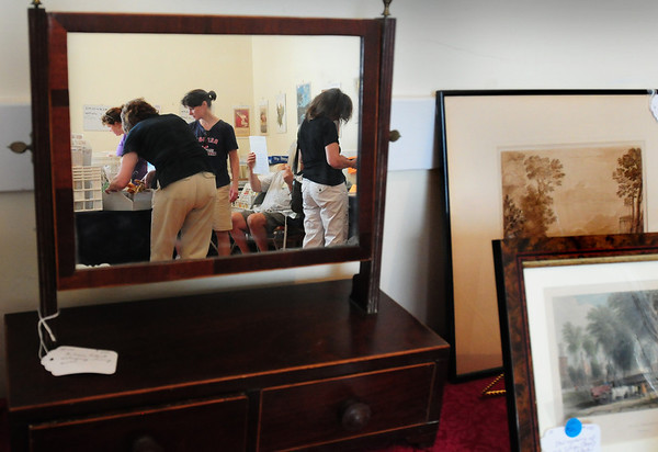 Newburyport: Browsers check out items at the Annual Antique Show and Sale at the Belleville Church. Bryan Eaton/Staff Photo