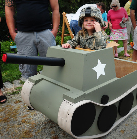 "Newburyport: ""GI Jane"" Julianna Bucknill, 5, of Newbury looks out of her tank in the carriage parade at Kids Day in the Park. Bryan Eaton/Staff Photo"