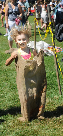 Newburyport: Ava Basker, 7, visiting from Worcester, competes in the sack race at Yankee Homecoming's Old-Fashioned Sunday on the Mall.  Jim Vaiknoras/Staff photo