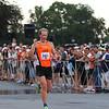 Newburyport: Justin Freeman of New Hampshire crosses the finish line, winning this years Yankee Homecoming men's 10 mile road race. Photo by Ben Laing/Staff Photo