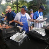 Newburyport: The crew from Opportunity Works serve up burgers and hot dog, an annual tradition at Family Day at Maudslay Saturday. Jim Vaiknoras/Staff photo