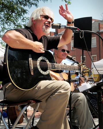 Newburyport: Jim Grenier, left, and Bob Brun of the Newburyport-based Stellwagen perform in Market Square yesterday. Bryan Eaton/Staff Photo