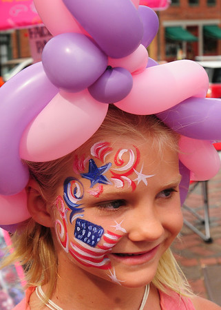 Newburyport: Schuyler Lloyd, 6, of Newburyport shows off her painted face by Irina of New Orleans in Market Square. Bryan Eaton/Staff Photo