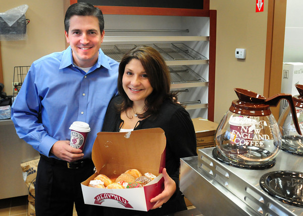Amesbury: Chris Komburas and and his wife Essie are opening their eighth location of Heav'nly Donuts inside the new Irving gas station. Bryan Eaton/Staff Photo