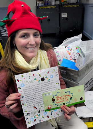 Georgetown: Jill Dunning, a supervisor at the Georgetown Post Office, has been answering letters to Santa Claus from youngsters in the area. Bryan Eaton/Staff Photo