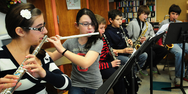 "Newbury: Newbury Elementary School's ""Chamber Winds"" ensemble, a selec group of sixth grade musician, played seasonal music including traditional Christmas songs Tuesday morning for attendees at the town's senior center which is in the school. Bryan Eaton/Staff Photo"