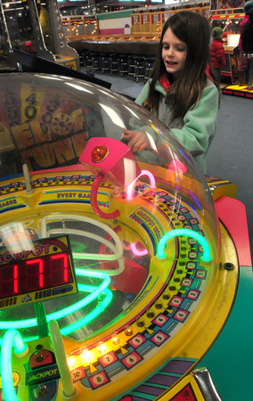 Salisbury: Abbie Magee, 10, of Rowley scores points on the game Storm Stopper at Joe's Playland at Salisbury Beach yesterday afternoon. The Pine Grove School student, on vacation this week, was there with her dad trying to win as many tickets as she could. Bryan Eaton/Staff Photo